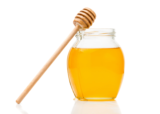 Natural honey in a glass jar