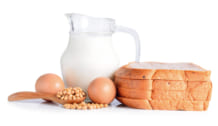 eggs ,soybeans ,milk and bread on white background.