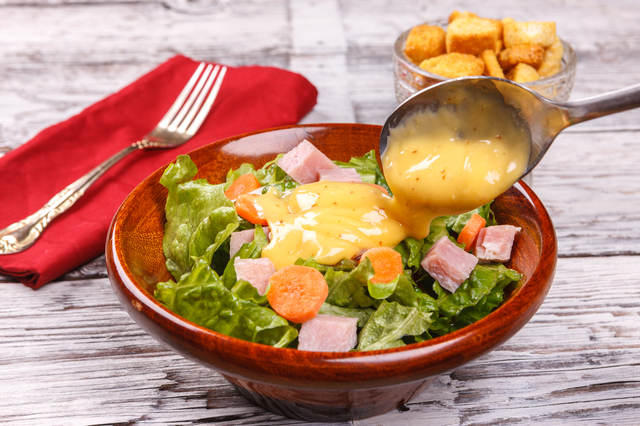 Close up of a delicious salad with honey mustard dressing.