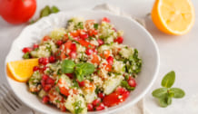 Tabbouleh salad with tomato, cucumber, couscous, mint and pomegr