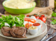 Beef steak with salad, mozzarella and tomatoes, two dip and mashed potato behind